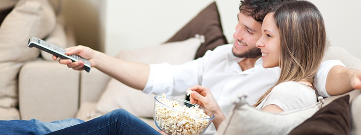 couple on couch watching television
