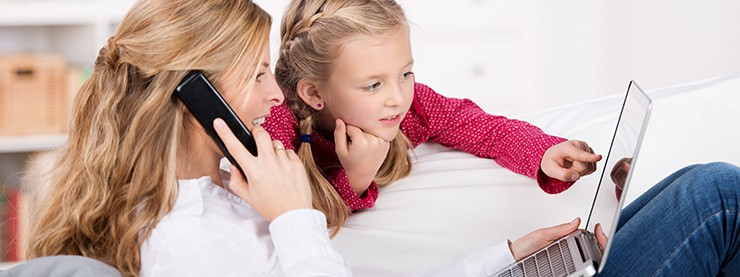 woman on phone with daughter looking at laptop